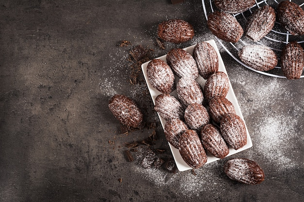 Homemade chocolate madeleines on dark table Premium Photo
