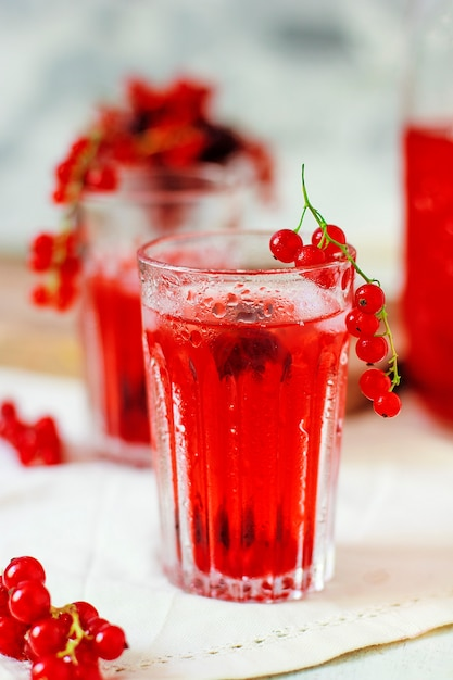 Homemade cold red currant berry drink Free Photo