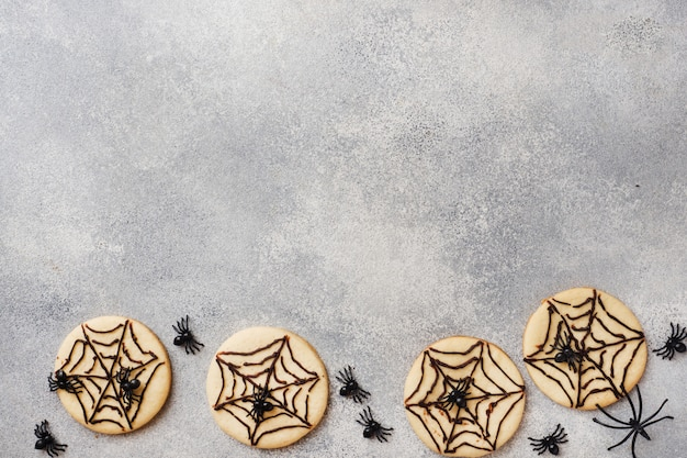 Homemade cookies for halloween, cookies with chocolate web and spiders Premium Photo