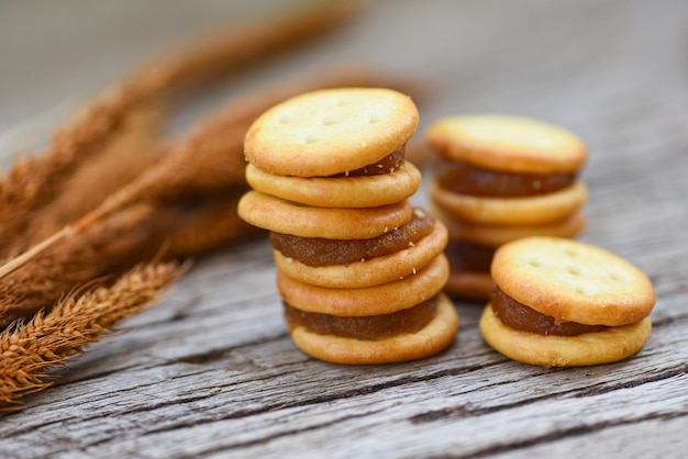 Homemade cookies with jam pineapple biscuits cookies on wooden for snack cracker Premium Photo