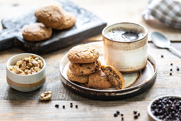 Homemade cookies with nuts and hot coffee in a ceramic cup Premium Photo