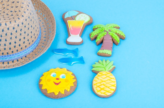 Homemade cookies with summer theme on blue background. Premium Photo