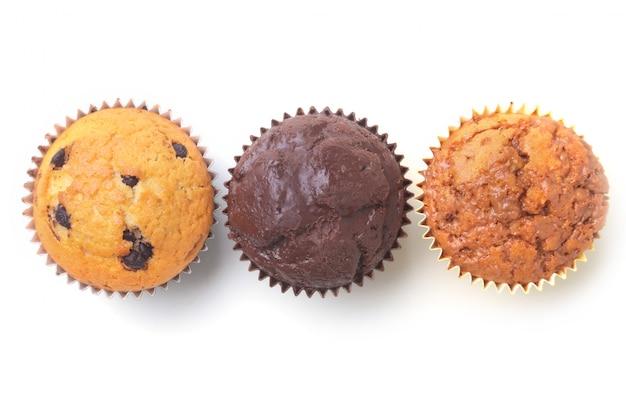 Homemade cupcakes with raisins and chocolate. muffins. Premium Photo