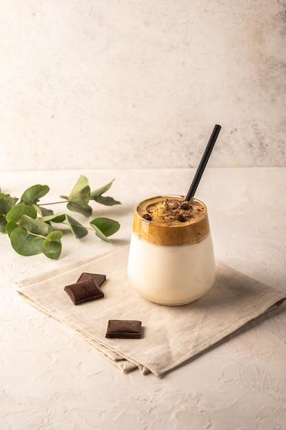 Homemade dalgona coffee with chocolate on napkin on light background. Premium Photo