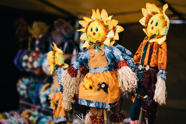 Homemade dolls at shrovetide. traditional straw effigy, for the traditional slavic holiday.  stuffed with the head of the sun Premium Photo