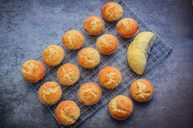 Homemade durian cupcakes on rock table. Premium Photo