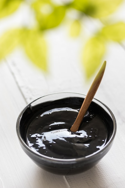 Homemade facial mask and scrub by activated charcoal powder and yogurt Premium Photo