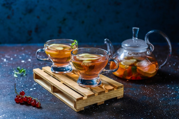 Homemade fruit and berry tea with mint. Free Photo