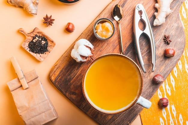 Homemade ginger tea with honey in glass teapot Premium Photo