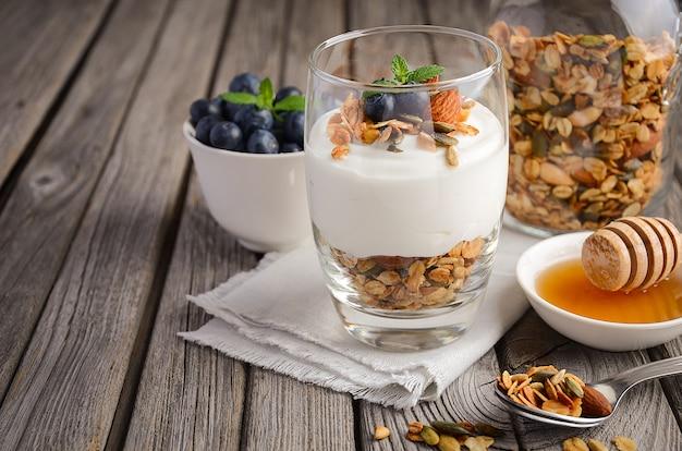 Homemade granola with yogurt and fresh blueberries Premium Photo