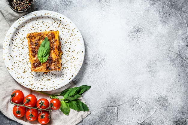 Homemade italian lasagna with tomato sauce and beef. space for text Premium Photo