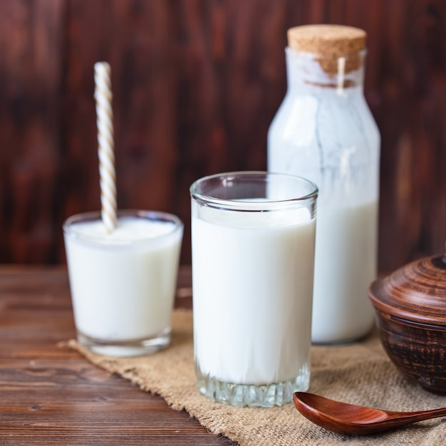 Homemade kefir, yogurt with probiotics in a glass on table probiotic cold fermented dairy drink trendy food and drink copy space rustic style. Premium Photo