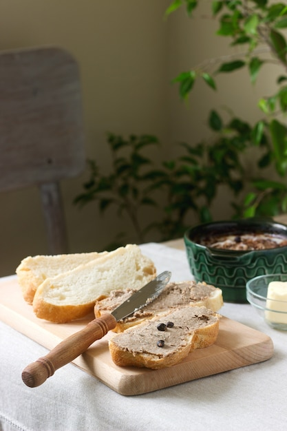 Homemade liver pate with bread and butter. rustic style. Premium Photo