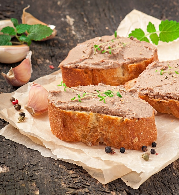 Homemade meat snack chicken liver pate with savory and olives Free Photo