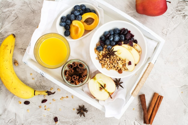 Homemade muesli with apple and blueberry Premium Photo