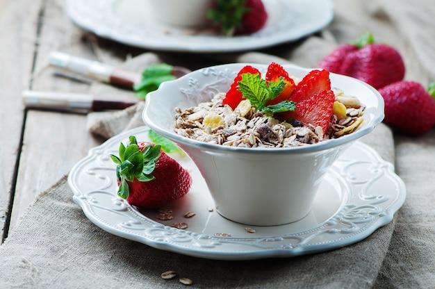 Homemade muesli with strawberry and mint Premium Photo