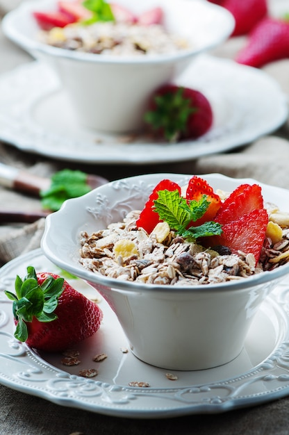 Homemade muesli with strawberry and mint Premium Photo