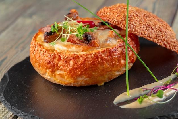 Homemade mushroom cream soup, served in bread bowl Premium Photo