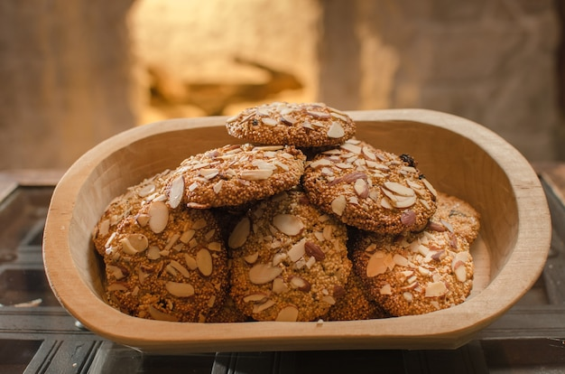 Homemade oatmeal cookies with seeds in a wooden bowl Free Photo