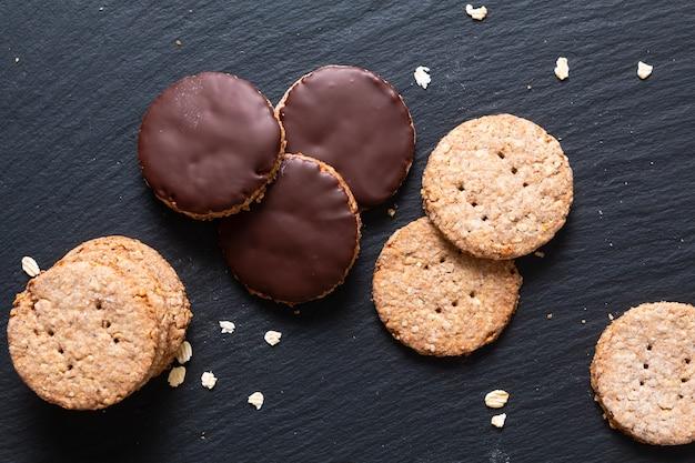 Homemade organic digestive oat and wheat bran chocolate dipped cookies Premium Photo