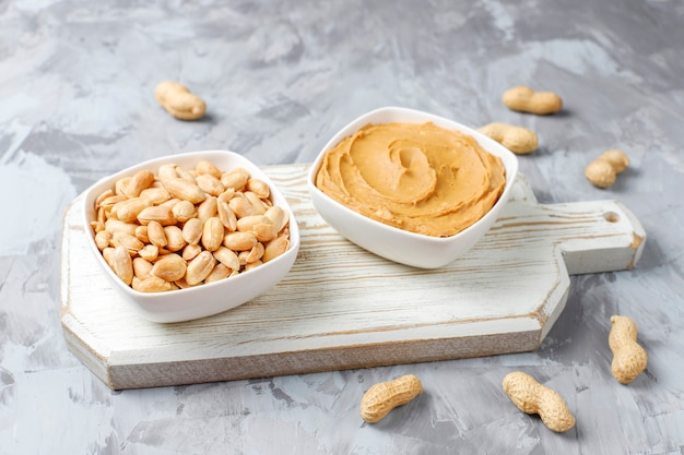 Homemade organic peanut butter with peanuts Free Photo