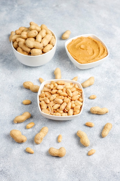 Homemade organic peanut butter with peanuts. Free Photo