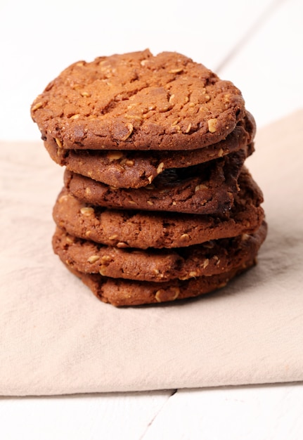 Homemade outmeal brown cookies on a table Free Photo