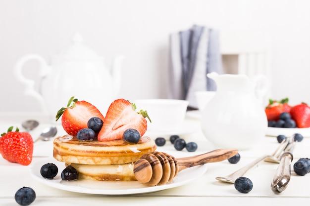 Homemade pancakes with berries. Premium Photo