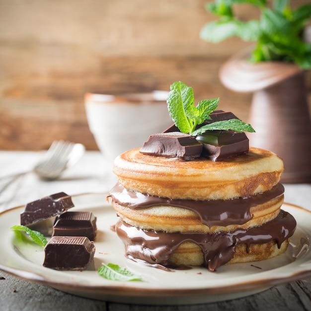 Homemade pancakes with chocolate spread. Premium Photo
