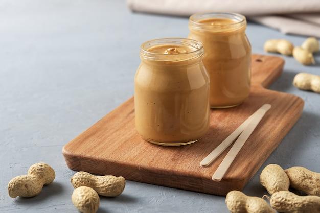 Homemade peanut butter in glass jars Premium Photo