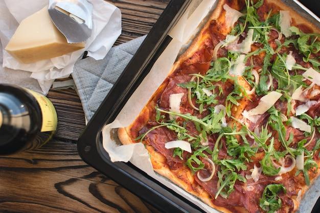 Homemade pizza prosciutto crudo and arugula Free Photo