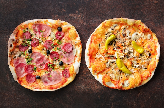 Homemade pizza. top view with copy space on dark stone table Premium Photo