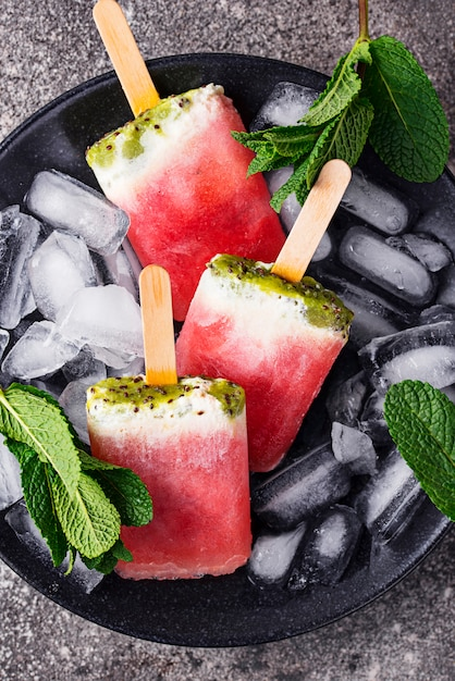 Homemade popsicles in shape of watermelon Premium Photo
