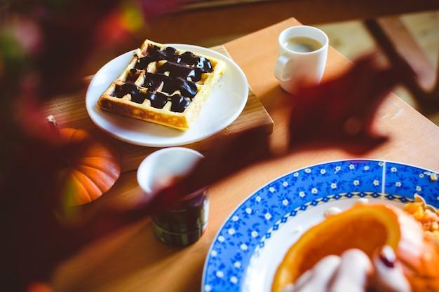 Homemade pumpkin waffle with dark chocolate topping Free Photo