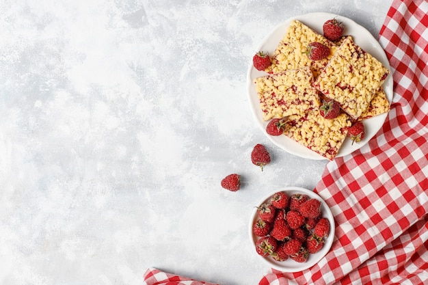 Homemade raspberry crumble bar on plate on light Free Photo