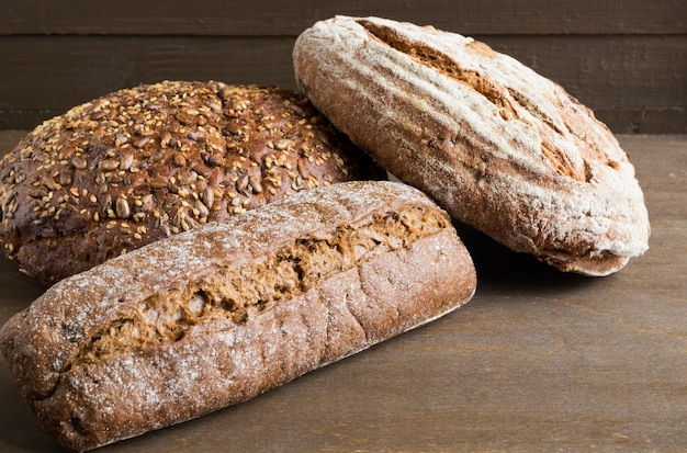 Homemade rustic rye bread on a dark background. Premium Photo