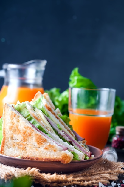 Homemade sandwich with salad and juice as a healthy breakfast Premium Photo