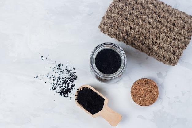 Homemade scrub made of sugar and ground coffee. spa, beauty skincare body concept. Premium Photo