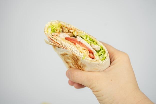Homemade shawarma / burrito / pita / chicken roll with vegetables and sauce. Premium Photo