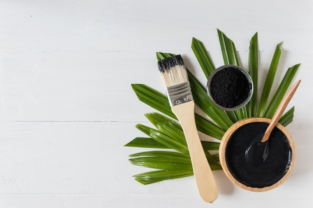Homemade skin remedies and facial care, activated black charcoal and yogurt mask, cosmetic product Premium Photo