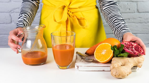 Homemade smoothie composition on table Free Photo