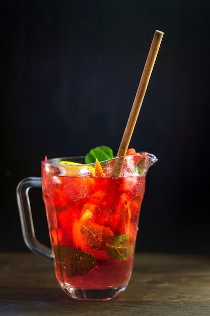 Homemade strawberry lemonade in a jar on black background Premium Photo