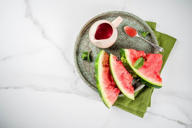 Homemade sweet and sour watermelon sauce, white marble background copy space Premium Photo