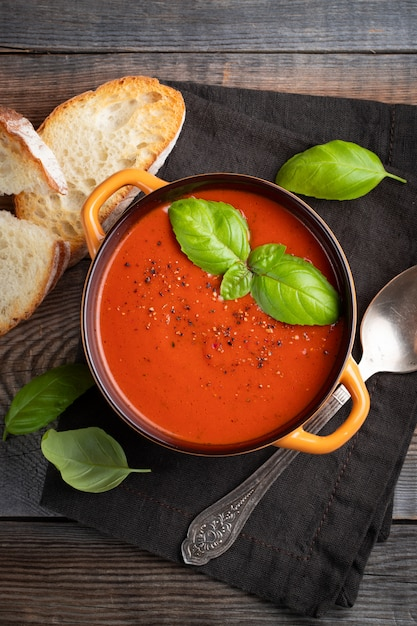 Homemade tomato soup with basil. Premium Photo