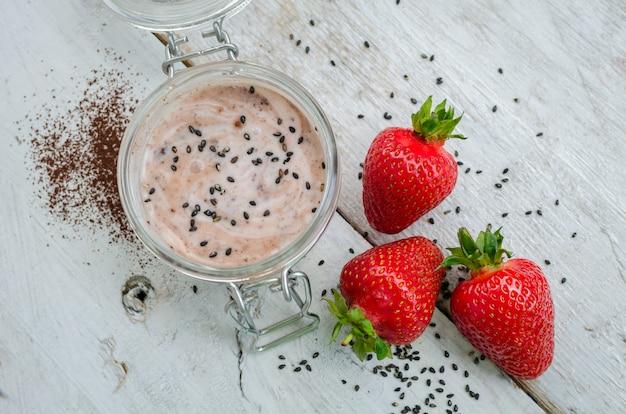 Homemade yogurt in a jar with strawberry Premium Photo