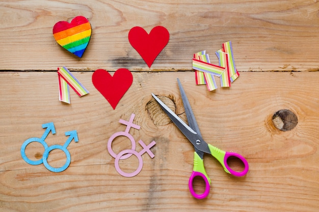 Homosexual couples icons with hearts and rainbows Free Photo