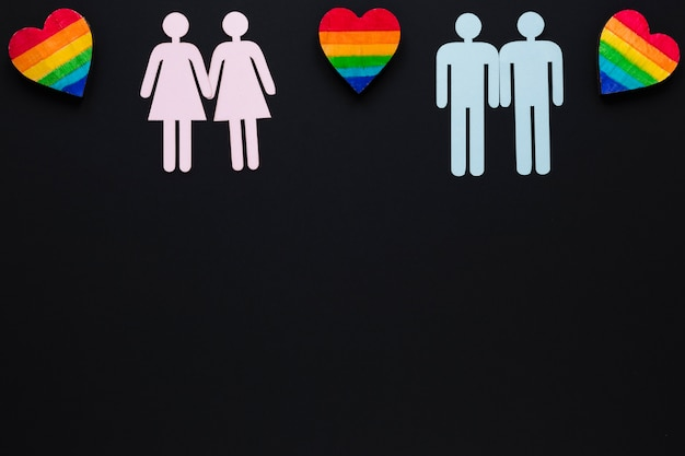 Homosexual couples icons with rainbow hearts Free Photo