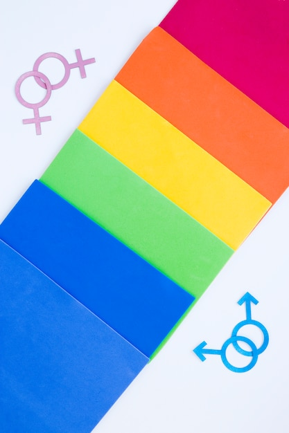 Homosexual couples icons with rainbow of papers Free Photo