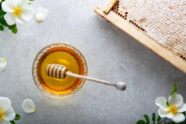 Honey background. sweet honey in the glass jar. Premium Photo