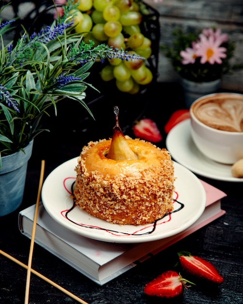 Honey cake with pear on the table Free Photo